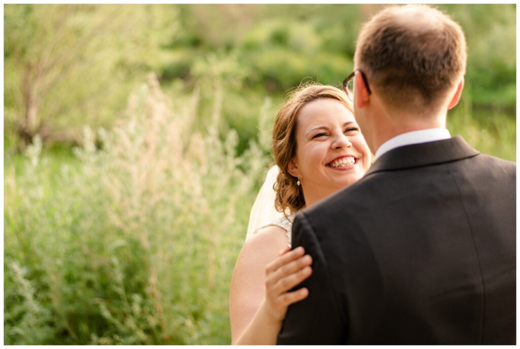 Colter & Jillyan - Encore Wedding Session - 05 - Bride smiling and laughing at groom