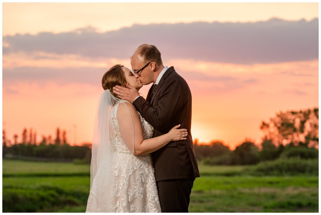 Colter & Jillyan - Encore Wedding Session - 16 - Sunset kiss of Bride and Groom