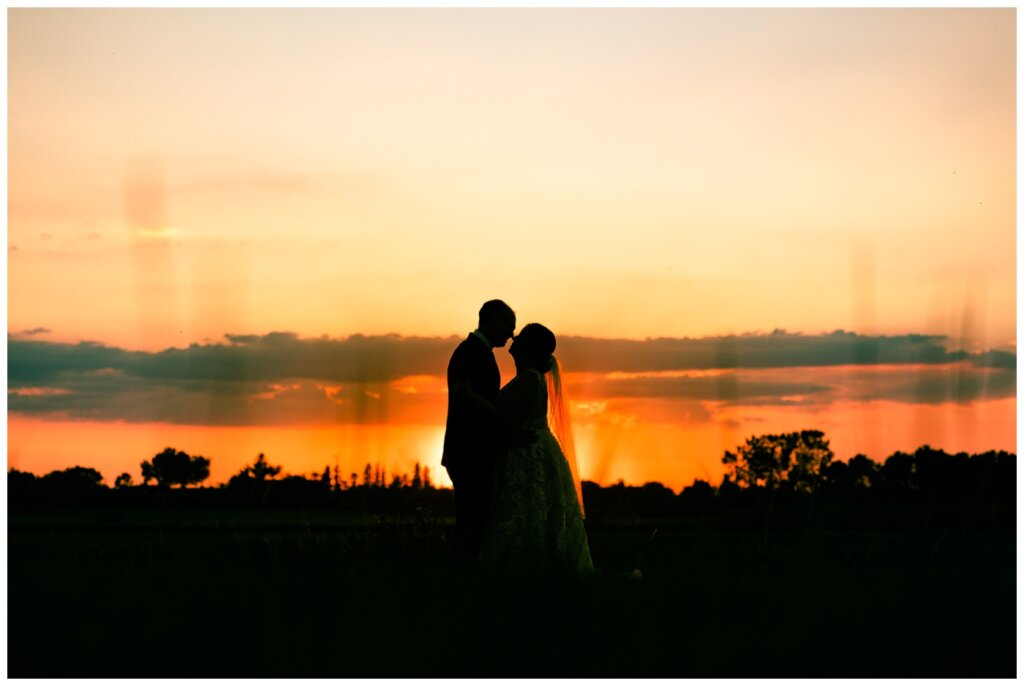 Colter & Jillyan - Encore Wedding Session - 17 - Silhouette of Bride & Groom at Sunset