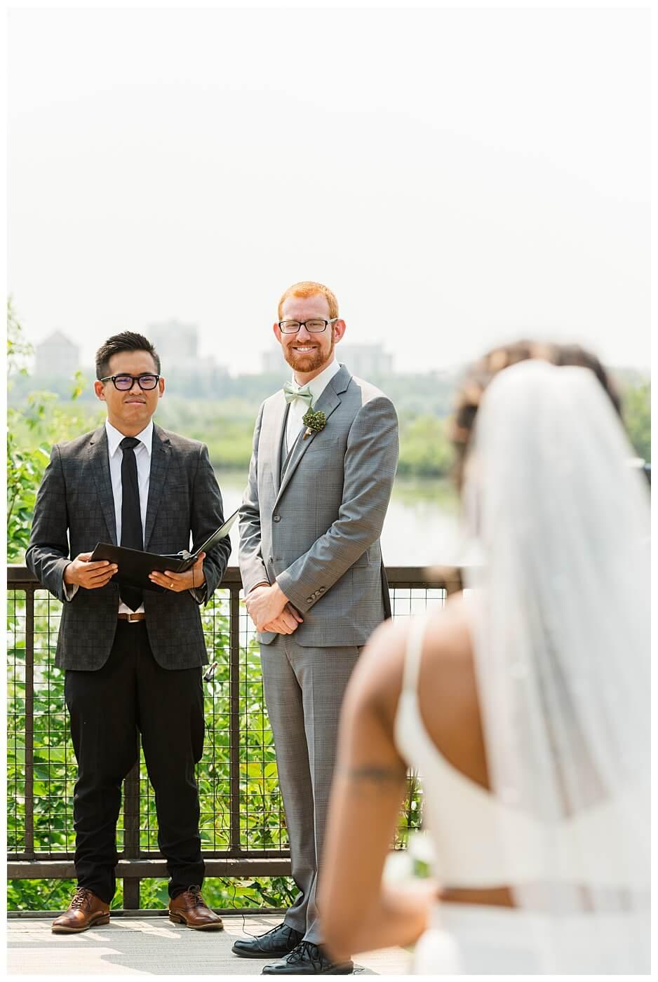 Stephen & Sarah Wedding - 09 - Bride processional toward groom at Wascana Park overlook