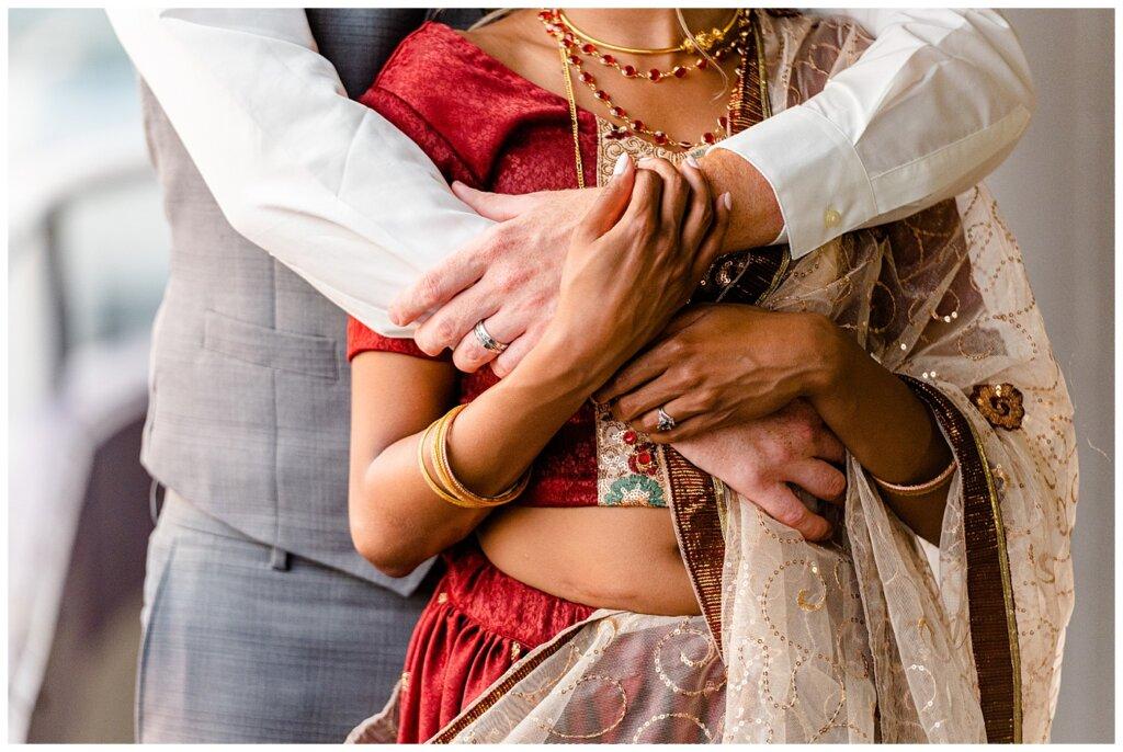 Stephen & Sarah Wedding - 26 - Close up of Bride's rings, bangals, and Langa
