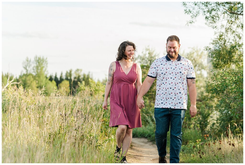 Mitch & Val - Engagement Session in Wascana Habitat Conservation Area - 01 - Engaged couple walking through park
