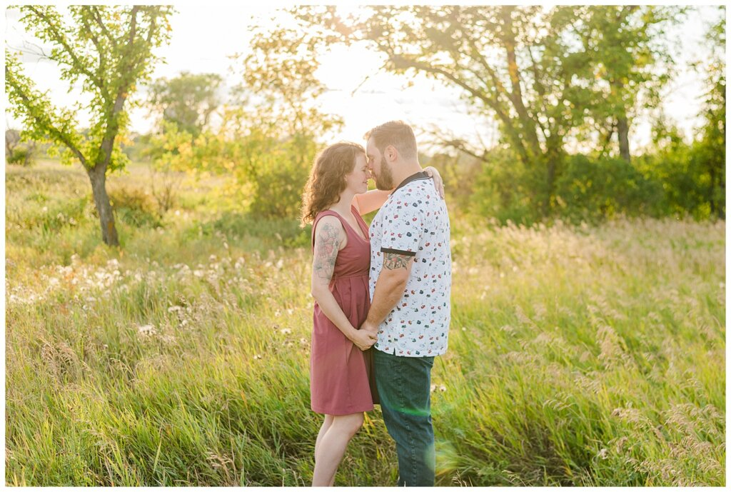 Mitch & Val - Engagement Session in Wascana Habitat Conservation Area - 03 - Man gently kisses fiancee on the nose
