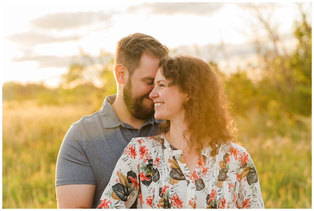 Mitch & Val - Engagement Session in Wascana Habitat Conservation Area - 10 - Man nuzzling into hair of woman