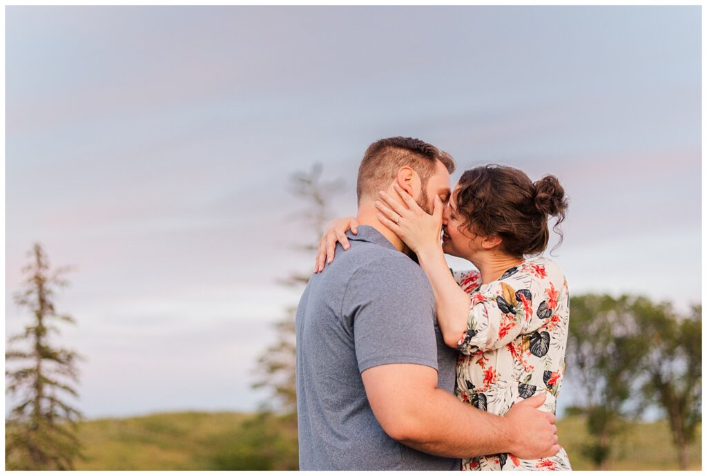 Mitch & Val - Engagement Session in Wascana Habitat Conservation Area - 13 - Couple going in for a giggling kiss