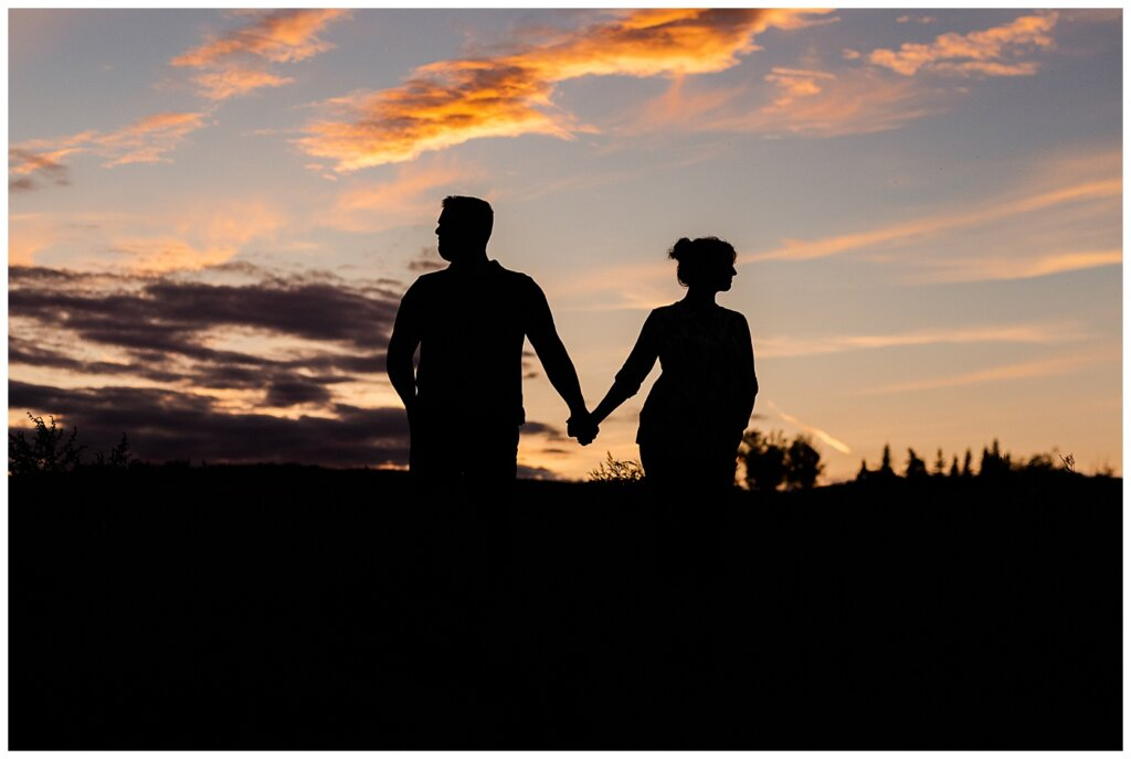 Mitch & Val - Engagement Session in Wascana Habitat Conservation Area - 15 - Silhouette of Couple at Douglas Park Hill