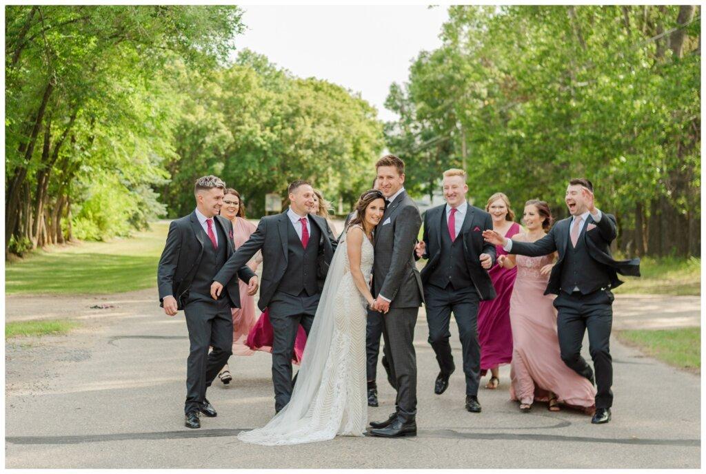 Taylor & Jolene - Emerald Park Wedding - 24 - Bridal party surprises Bride & Groom