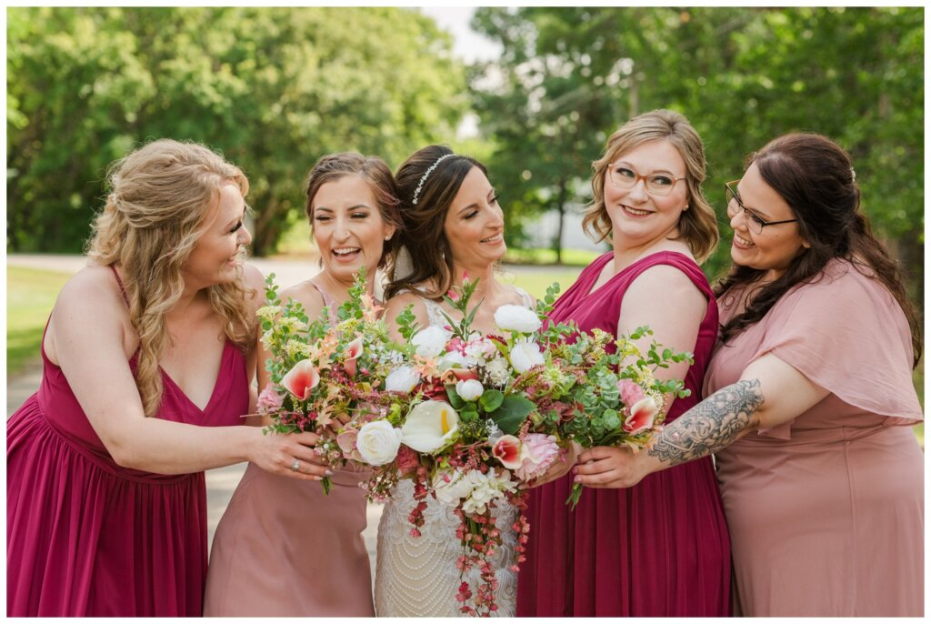 Taylor & Jolene - Emerald Park Wedding - 26 - Bride with her bridesmaids dressed in pink