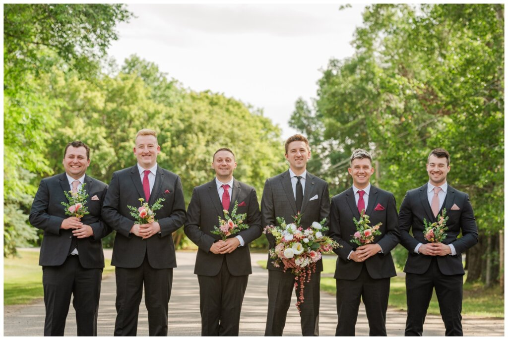 Taylor & Jolene - Emerald Park Wedding - 27 - Groom and groomsmen accessorize with bouquets