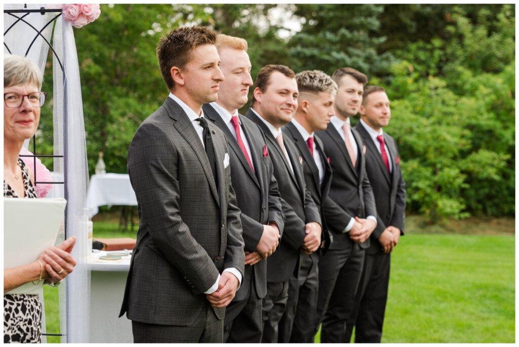 Taylor & Jolene - Emerald Park Wedding - 29 - Groom waits for his bride