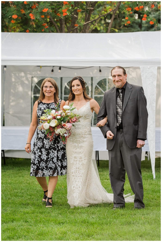 Taylor & Jolene - Emerald Park Wedding - 30 - Bride escorted by her parents