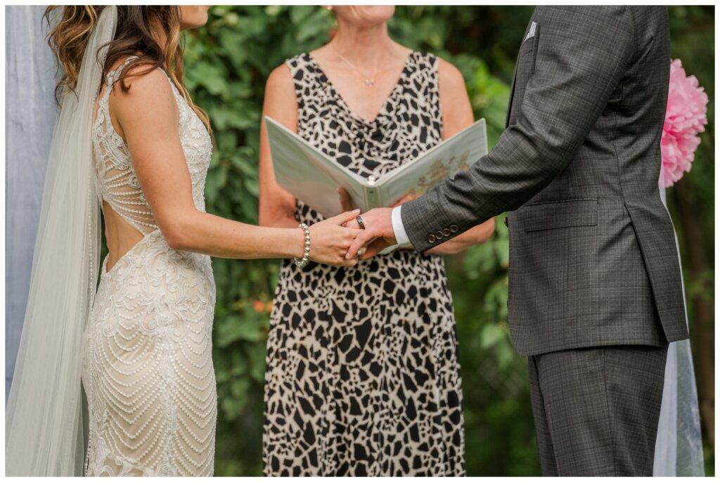 Taylor & Jolene - Emerald Park Wedding - 33 - Bride & Groom exchange rings