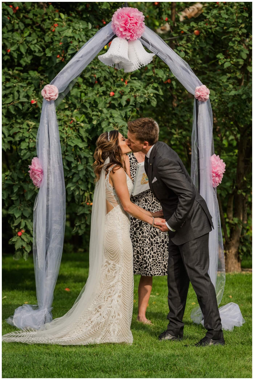 Taylor & Jolene - Emerald Park Wedding - 34 - First kiss as husband and wife