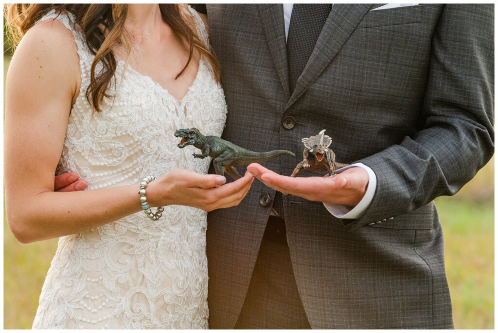 Taylor & Jolene - Emerald Park Wedding - 41 - Bride & Groom with dinosaurs
