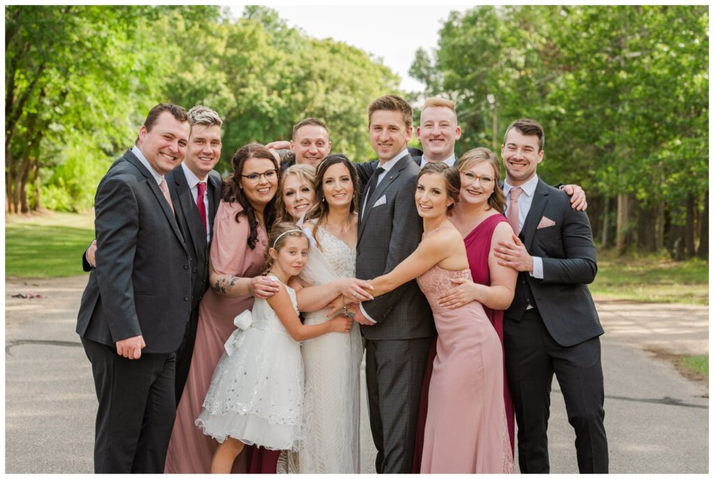 Taylor & Jolene - White City Wedding - 25 - Bridal party group hug