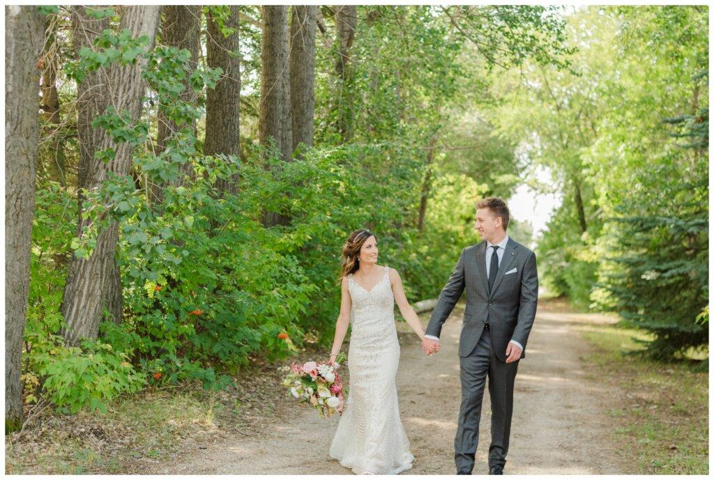 Taylor & Jolene - White City Wedding - 28 - Bride & Groom walking down the alley