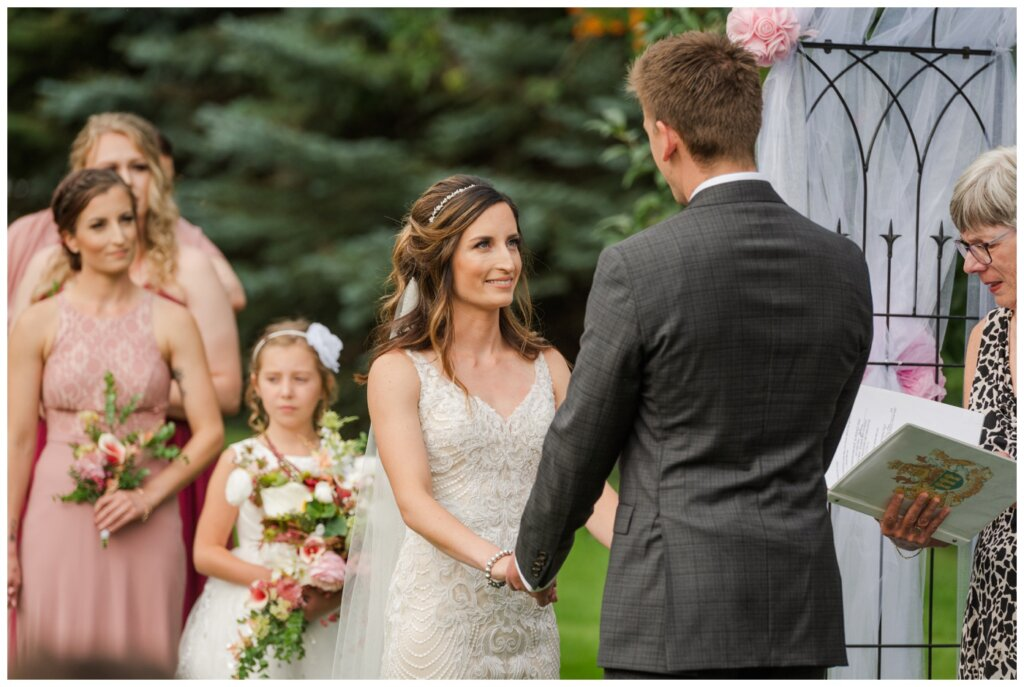 Taylor & Jolene - White City Wedding - 32 - Bride & Groom exchange vows