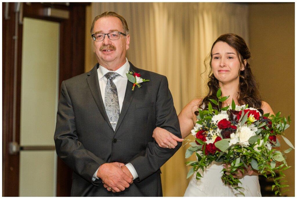 Andrew & Lacey - 13 - Sandman Hotel - Bride proceeding down aisle towards groom