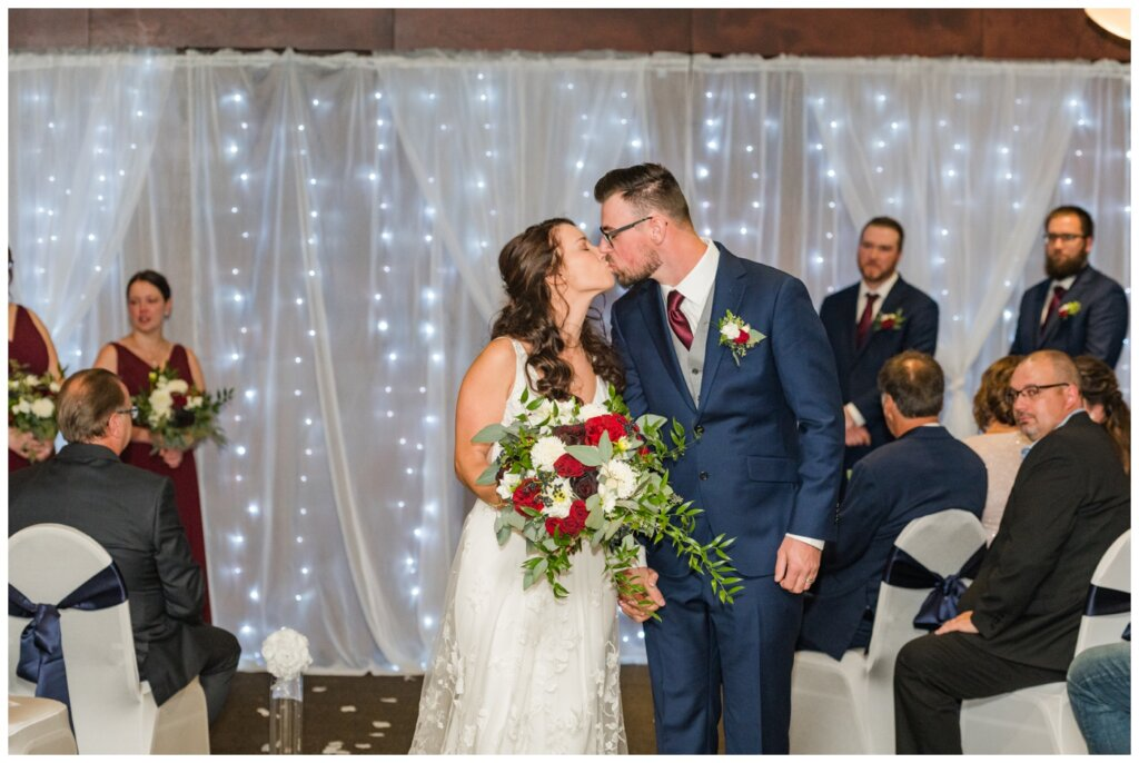 Andrew & Lacey - 16 - Bride & Groom Recessional Kiss
