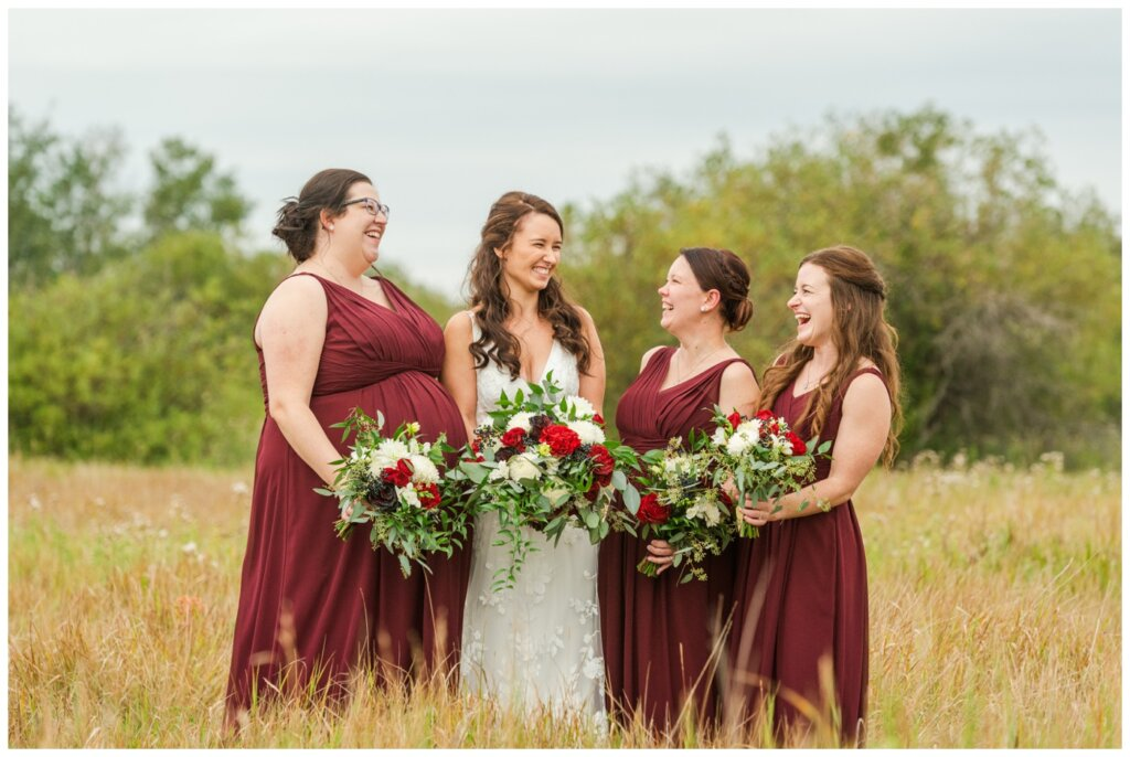 Andrew & Lacey - 34 - Bridal Party laughing in a field