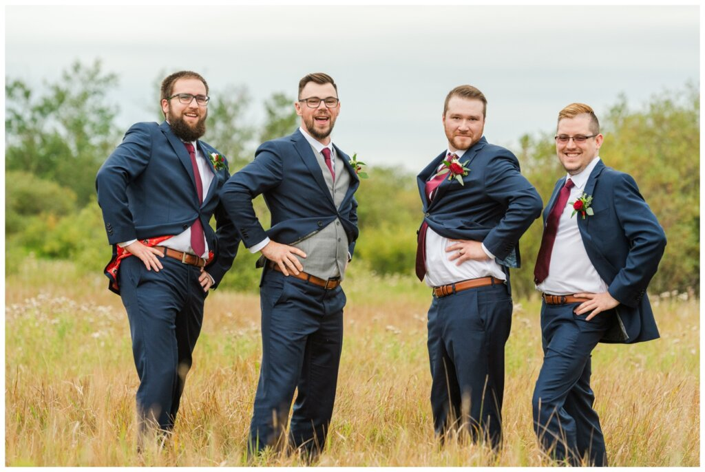 Andrew & Lacey - 35 - Groom and Groomsmen showing off their sass