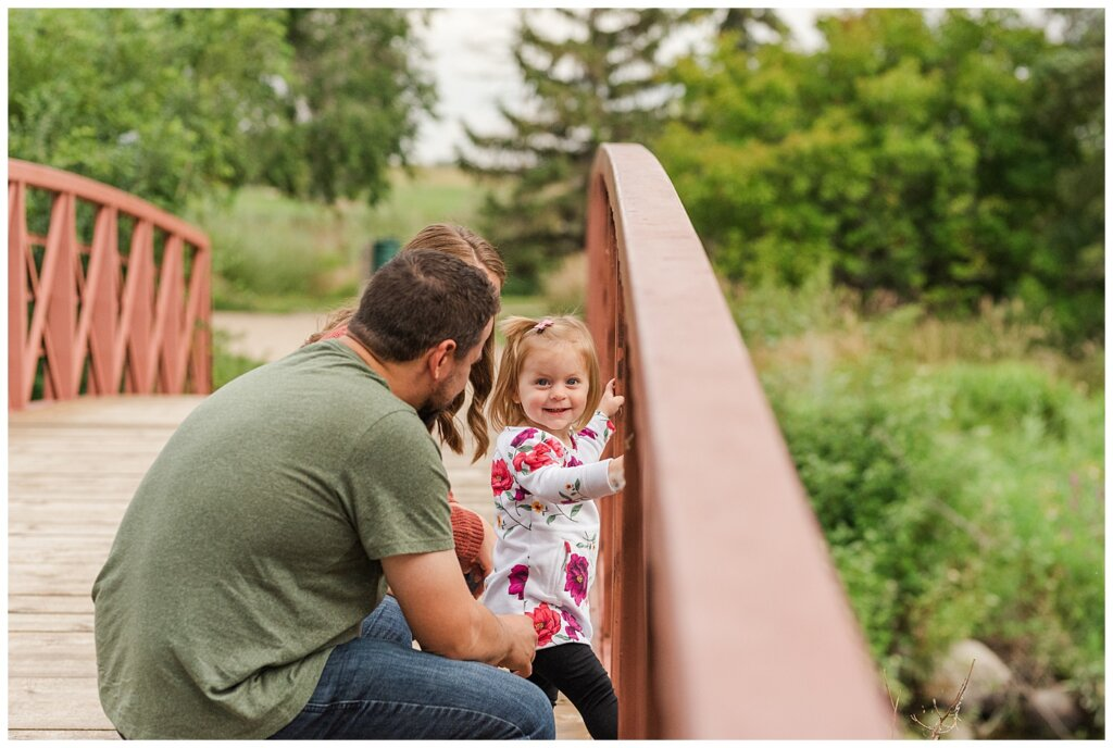 Eyre Family 2021 - AE Wilson Park - Family Photo Shoot - 02 - Daughter smiles on the bridge