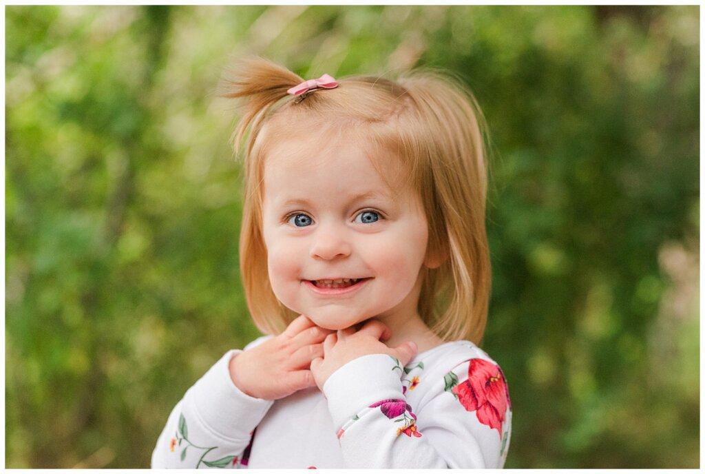 Eyre Family 2021 - AE Wilson Park - Family Photo Shoot - 03 - Little girl giggles
