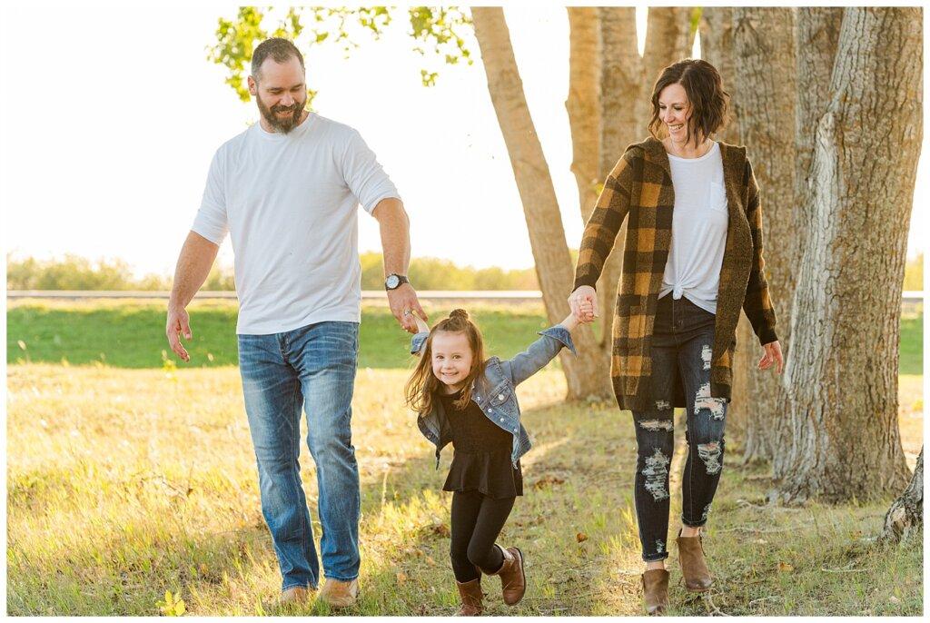 Kim & Lisa Korchinski - White Butte Trails - Family Photo Session 2021 - 01 - Daughter pulling parents