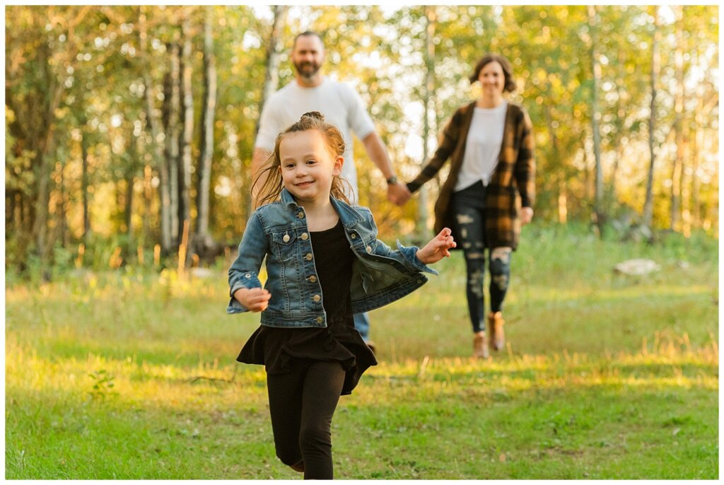 Kim & Lisa Korchinski - White Butte Trails - Family Photo Session 2021 - 03 - Daughter running in front of parents walking