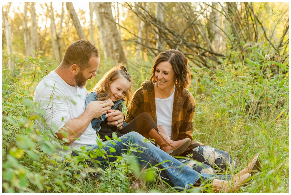 Kim & Lisa Korchinski - White Butte Trails - Family Photo Session 2021 - 05 - Dad tickling daughter in the forest