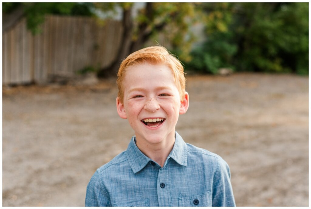 Schoenroth Family - Cathedral Village Regina - 04 - Little boy in denim shirt laughs