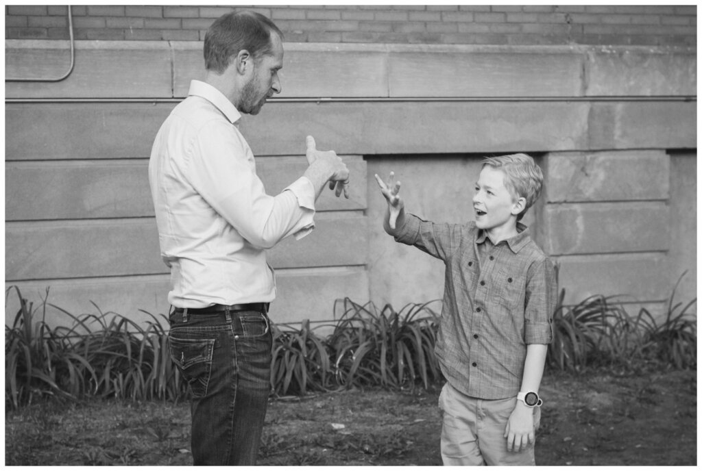 Schoenroth Family - Cathedral Village Regina - 18 - Father and son with their secret handshake