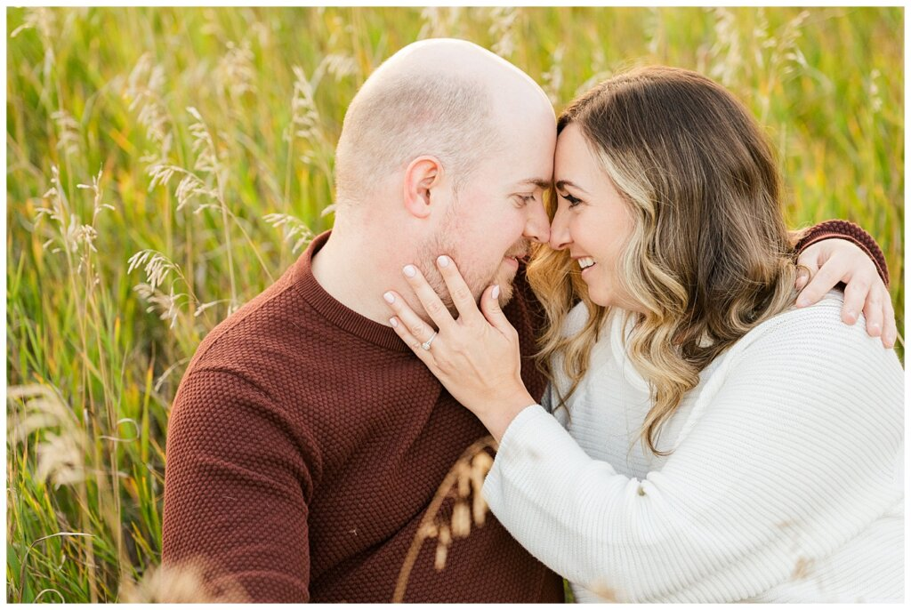 Trevor & Kim - Regina Engagement Session - Wascana Centre Habitat Conservation Area - 08 - Couple sitting staring at each other nose to nose