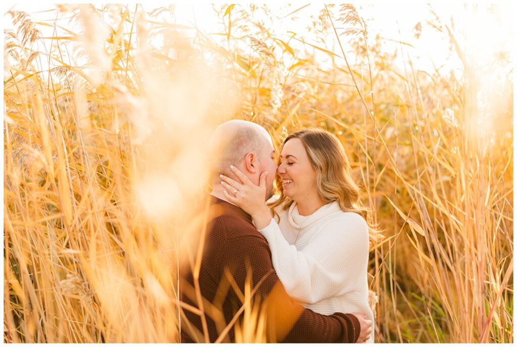 Trevor & Kim - Regina Engagement Session - Wascana Centre Habitat Conservation Area - 14 - Couple in long reeds and wheat