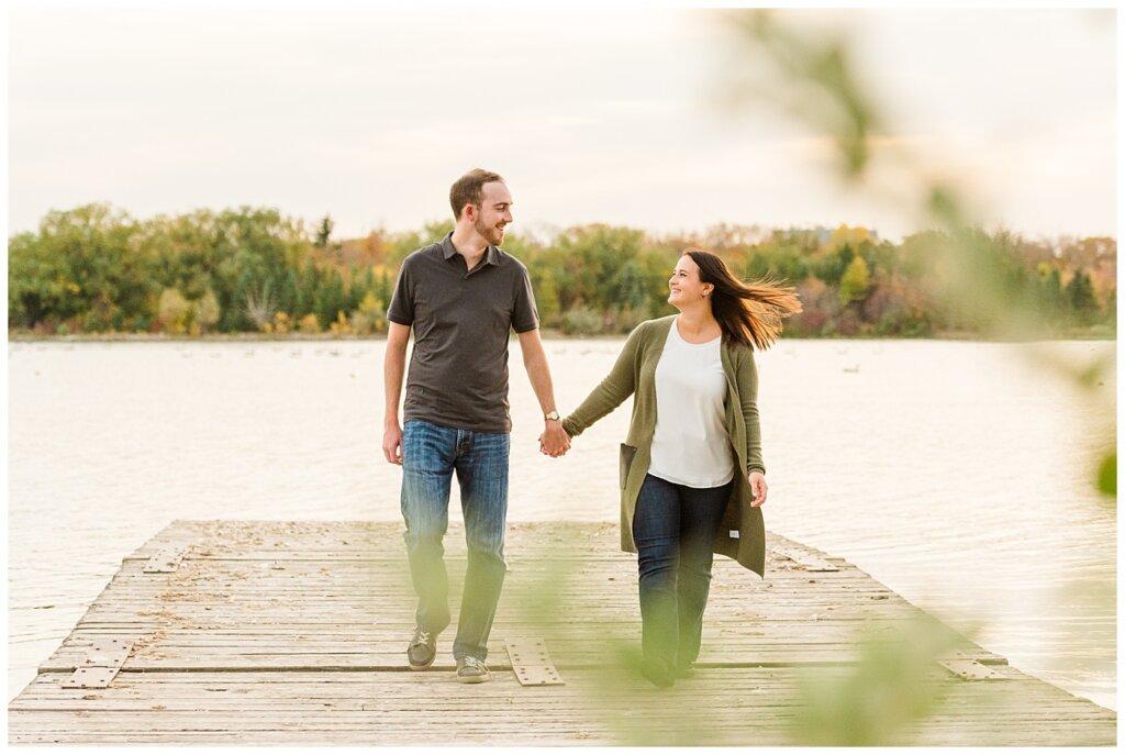 Andrew & Alisha - Engagement Session - 03 - Wascana Boathouse - Couple walking on dock