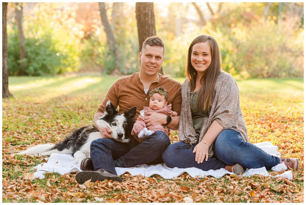 Filby Family - Regina Family Photography - Wascana Park - 01 - Family sitting in park with dog