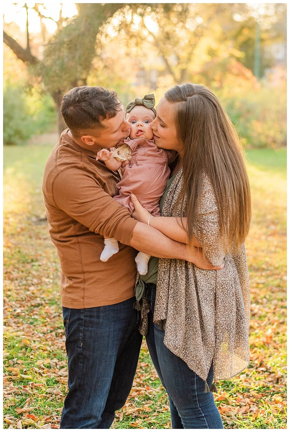 Filby Family - Regina Family Photography - Wascana Park - 07 - Mom and dad giving baby kisses on both cheeks