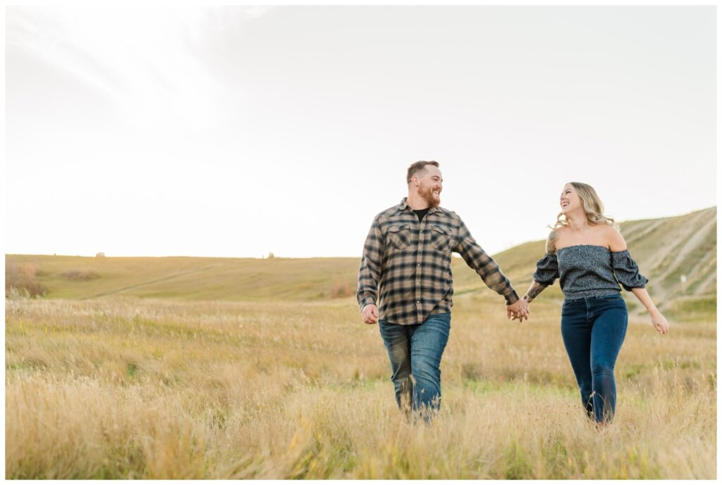 Jared & Jenna - Wascana Trails - 10 - Couple frolicking through a field