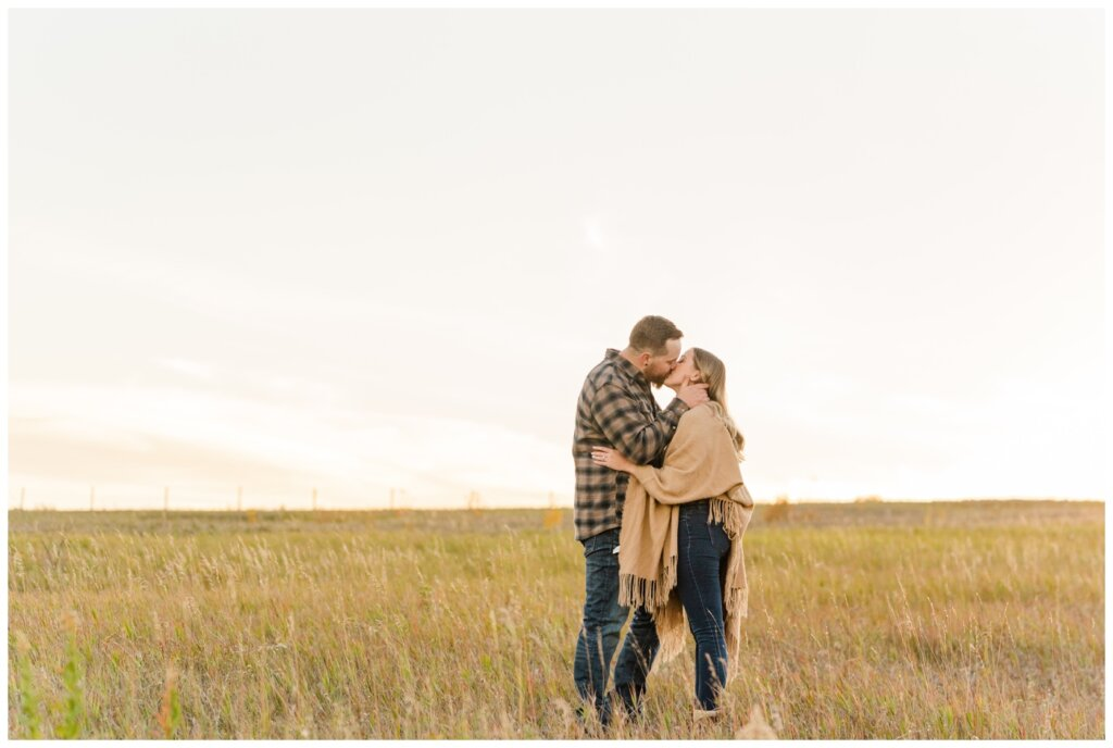 Jared & Jenna - Wascana Trails - 15 - Couple kissing nearing sunset