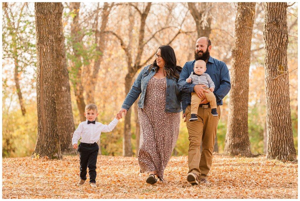 Nickel Family - Regina Science Centre - Family Photo Session - 01 - Family walking through the park