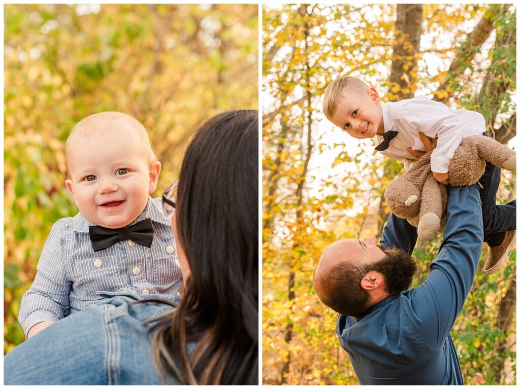 Nickel Family - Regina Science Centre - Family Photo Session - 09 - Theo looking over mom's should and dad lifting up Fox