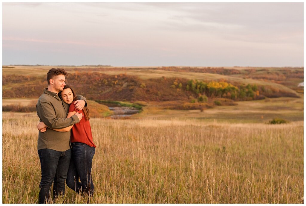 Tris & Jana - Engagement Session - Wascana Trails - 13 - Couple during sunset staring off in the distance