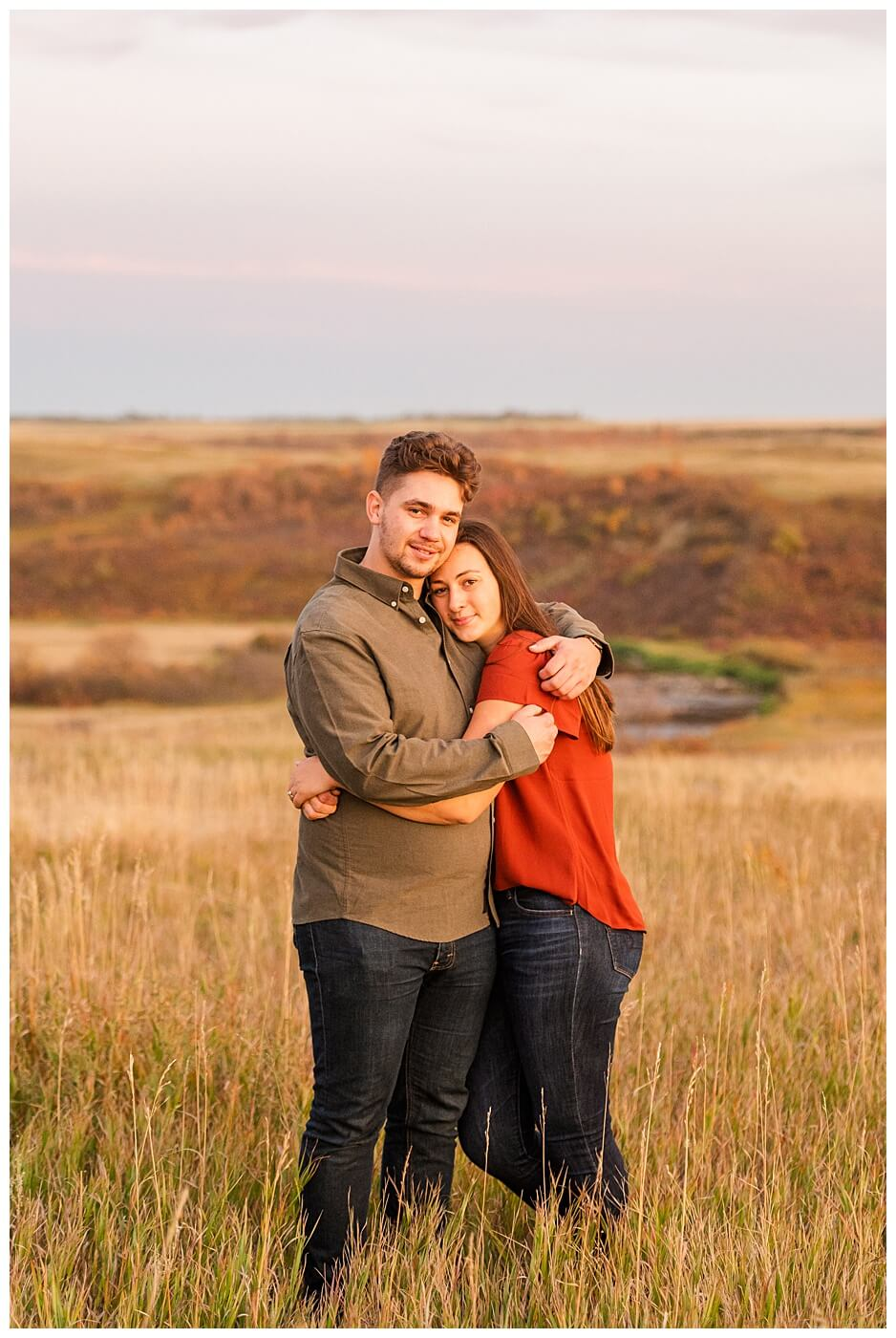 Tris & Jana - Engagement Session - Wascana Trails - 14 - Couple at top of valley during sunset