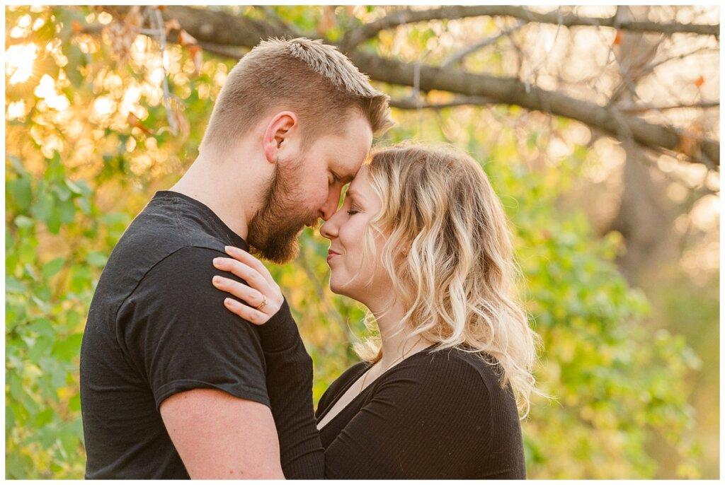 Tyrel & Allison - Regina Anniversary Session - Douglas Park Hill - 02 - Couple in golden light in fall