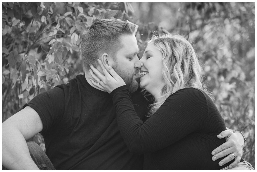 Tyrel & Allison - Regina Anniversary Session - Douglas Park Hill - 04 - Black and white of Husband and Wife kissing in park